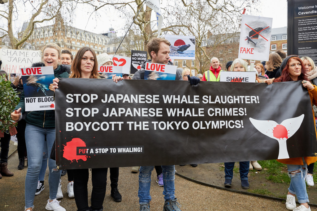 Protestors march in London to protest against Japan resuming commercial whaling.